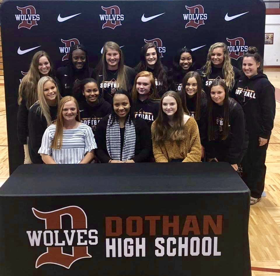 Softball signees with teammates